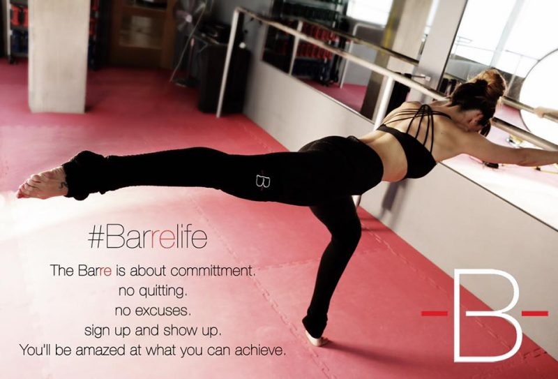 The Barre workout Instructor in an Arabesque position in a fitness studio fashion voyeur blog