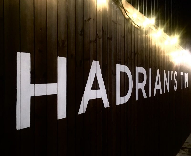 Hadrian's Tipi logo on the outside wall