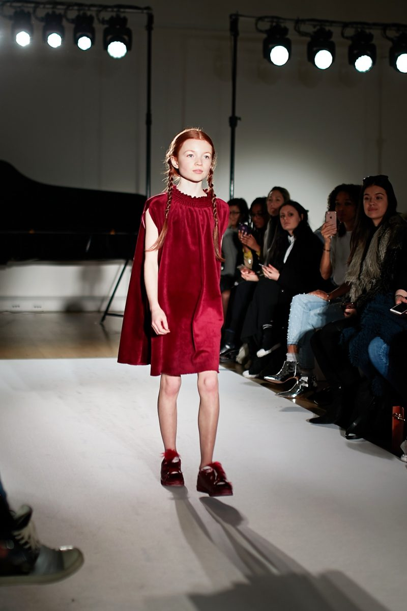A still image of a model walking the runway for Amelie et Sophie at mini Mode london Fashion Week