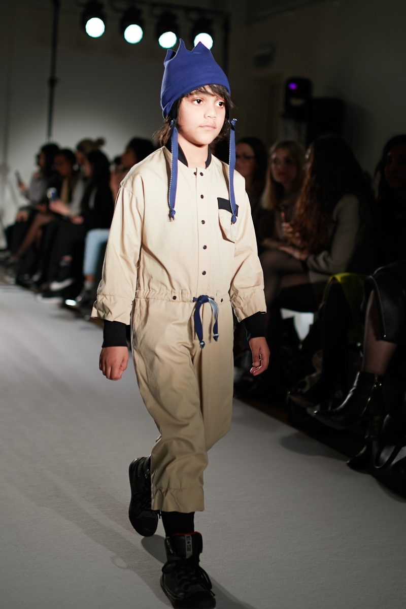 a still image of a child model walking the runway for designer Infantium Victoria at Mini mode London Fashion Week