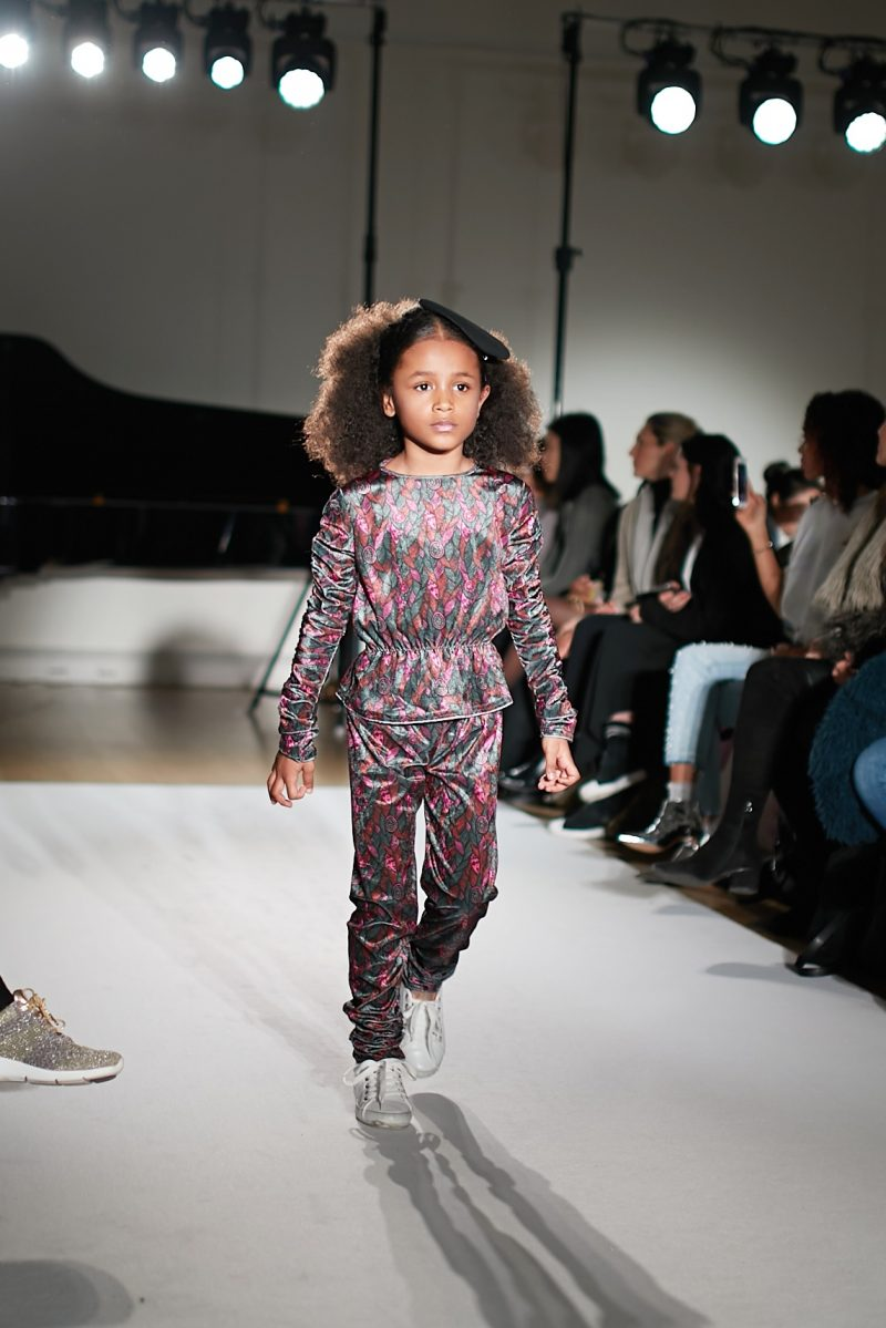 a still image of a child model walking the runway for Isossy Children at mini Mode London Fashion Week