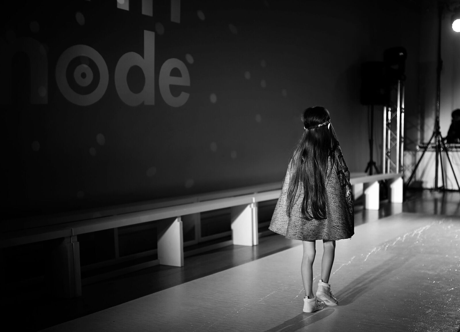 A picture of a child model on the runway for Mini Mode LFW