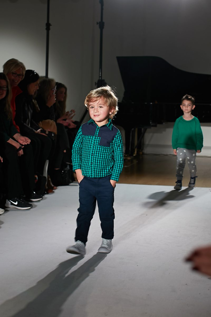 A still image of a child model walking the runway for kidswear designer Where's that Bear? at mini Mode London fashion week