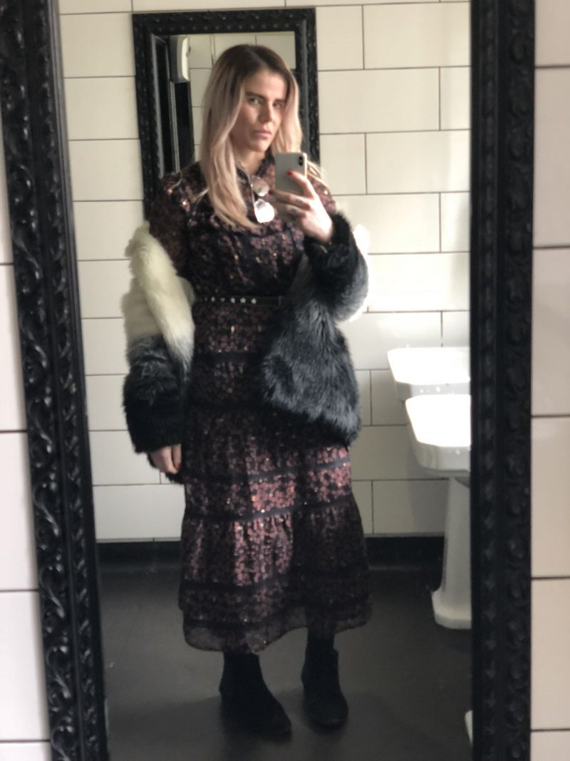 pixie Tenenbaum wearing a prairie girl dress and faux fur coat in day 3 of London Fashion Week fall Winter 2018