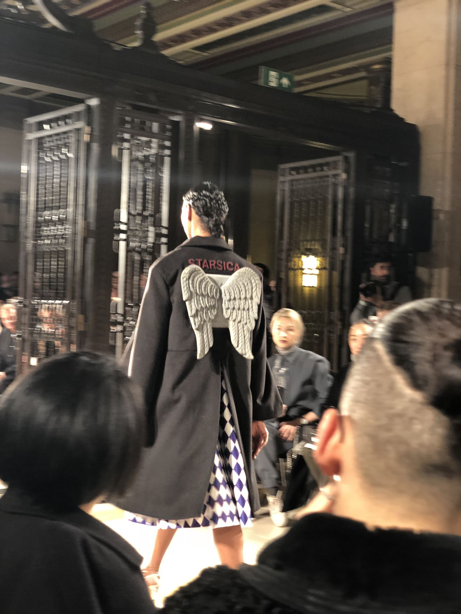 STARSICA FW18 LONDON FASHION WEEK a model with wings attached to the back of her coat
