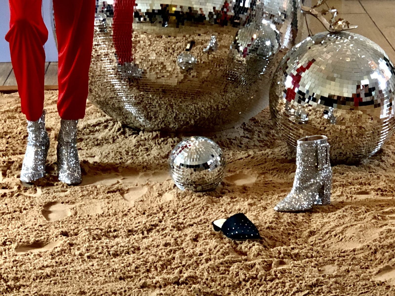 Alexander White FW18 London Fashion Week Lead Image of a disco ball and glittery cowboy boots
