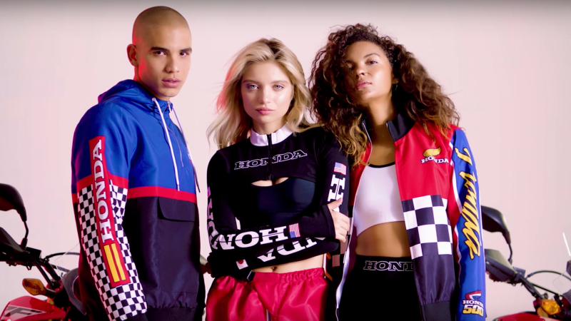 Group shot of 1 male model and 2 female models wearing race inspired pieces from the Honda x Forever 21 fashion collection