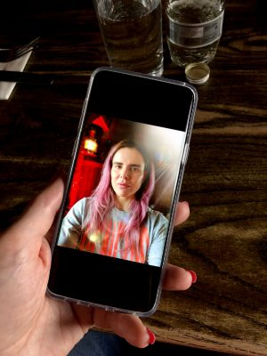 A test to illustrate the importance of screen variation in cellphones. The image of of a selfie which has been taken on a Samsung Galaxy S9 Plus and viewed on screen, then an image of the cellphone displaying that image has been taken using an iPhone X