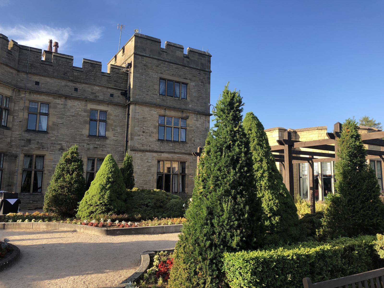 A landscape shot of the back of Slaley hall in northumberland with blue sky above