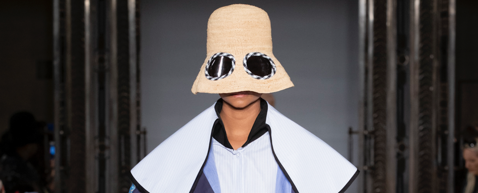 Simon Mo SS19 LFW Fashion Voyeur Blog Close up of a model wearing a hat with a low brim fitted with lenses
