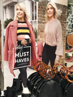 A shot of the Holly's Must Have's Edit at Marks & Spencer Newcastle Intu Eldon Square in December 2018 showing Holly Willoughby in a poster wearing some key pieces from the collection