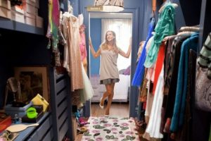 A shot of Carrie Bradshaw looking into her closet longingly - Fashion Voyeur Blog