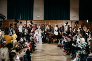Wide shot of the models on the stage with designer Chanel Joan Elkayam after the FW19 show at London Fashion Week. Fashion Voyeur blog by Pixie Tenenbaum